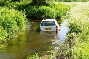 Car trapped in flooding  in the road