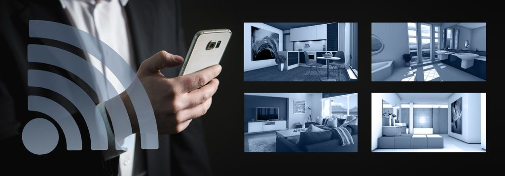 An image of a person holding a phone with screens from a building security management application,